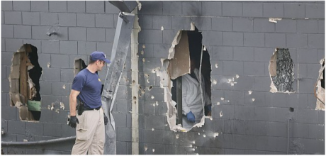 POLICE ARMORED VEHICLE CREATES HOLE IN CLUB WALL